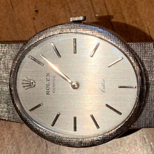 ONE OF A KIND ROLEX WATCH! Solid 18k white gold including band!