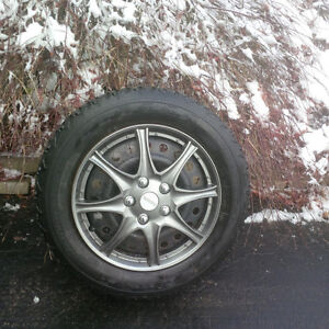 205 60 16 Firestone Winter Force on 5x114.3 Rims with Hubcaps