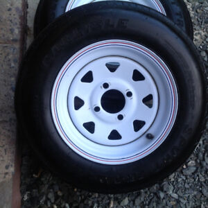 Two trailer tires on 12 inch rims (4 on 4 bolt pattern)