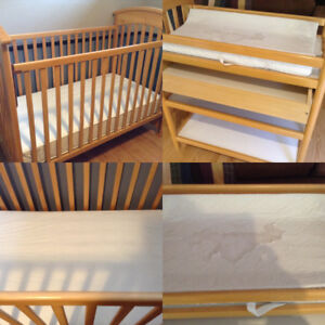 Maple crib and change table includes mattress.