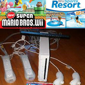 Wii console + 2 Wiimotes + 2 Nunchuks + 2 Motion Plus + 2 games