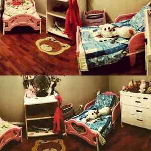 Pink toddler bed.