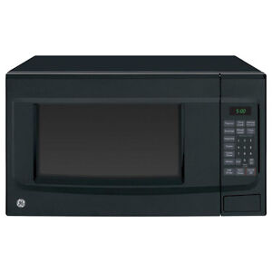 1.4 cu. ft. Countertop GE Microwave in Black, new/exc condition