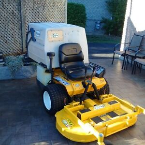 2012 GHS 23 HP WALKER MOWER  $7200
