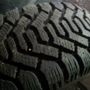 P215/60R15 Goodyear Nordic Snow tires on Rims
