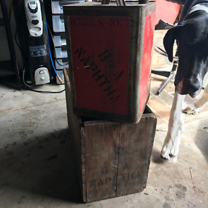 Large square oil can in original wood crate.