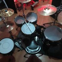 Want to learn drums? Experienced drummer for hire!