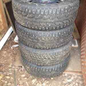 """17 """" studded tires on steel rims   1yr old only 2000 km's"""