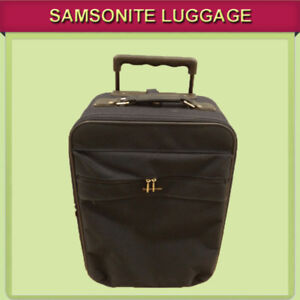 LARGE SAMSONITE SUITCASE ON WHEELS