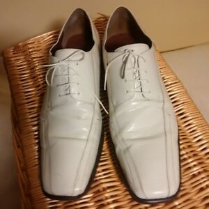 White Leather shoes size 14.