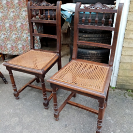 A matching pair of antique mahogany and cane chairs