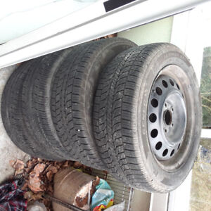 4 Used 205/55 R 16 tires with rims