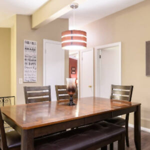 Gorgeous year old dining room table with bench seating