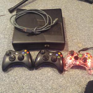 Xbox 360 · 3 controllers · 20 games · 100GB hard drive