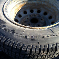 A set of 4 on toyota steel rims 195/70R14 Cooper weather master