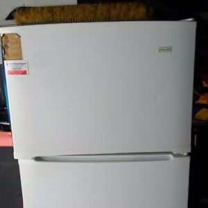 White Fridge Magic Chef 66 high by 30 wide and 29 deep