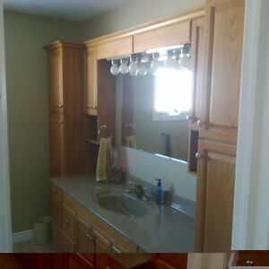 Oak Bathroom Cabinets and marble counter top and sink