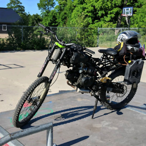 Motoped Survival  with a 125 dirtbike to ride or swap the motor.