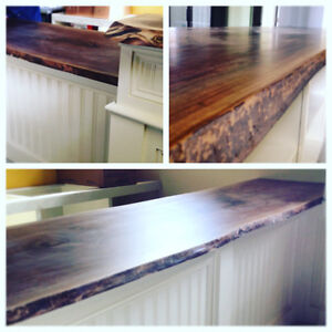 Walnut live-edge countertop and wooden cabinetry
