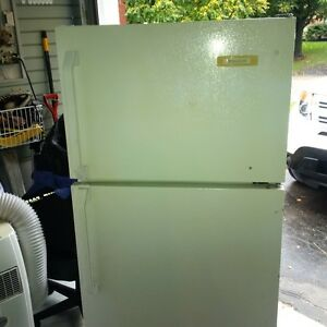Apartment sized fridge 23 wide x 27 deep and 61 high
