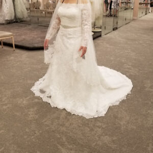 Wedding dress size 12 with shoes and all accessories for 2500.