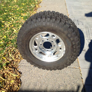 2 Goodyear LT245/75R16 Tires on Aluminum Rims for sale.
