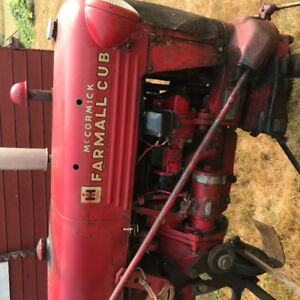 IH McKormik Farmall Tractor with snow plow, chains and more