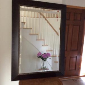 Tall mahogany framed mirror