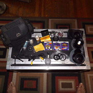 assorted camera lens, adapters,telephoto, wide angle etc
