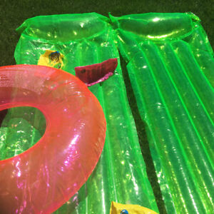 two air mattress and swimming ring