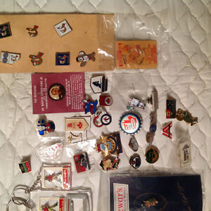 Collection of vintage lapel pins.