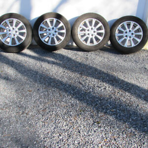 FOR SALE:  CAR TIRES 235/55R17 WITH RIMS & HUBCAPS