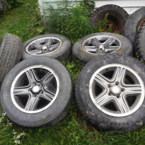 215 65 16 Jeep tires and rims (4)