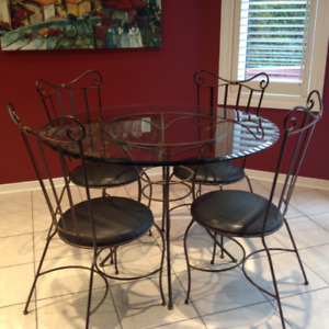 Wrought iron glass table and 4 chairs