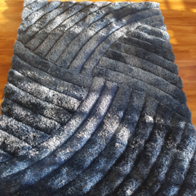 New blue 3d rug in a swirl design.nice thick pile