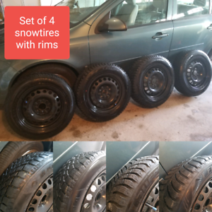 SET OF 4 SNOW TIRES WITH RIMS. 185 65/R15. 5x114.3