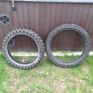 Dirt bike tires.  Front and rear. 19 rear, 21 front, front rim