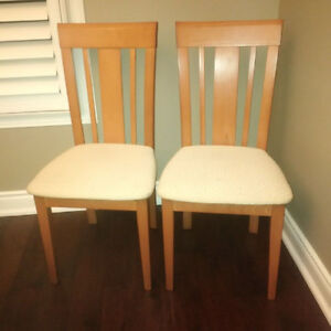 2 wooden kitchen chairs with fabric seats
