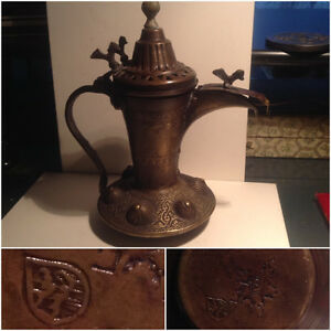 ANTIQUE ARABIC DALLAH COPPER COFFEE POT WITH BIRD DETAIL .