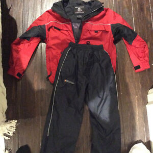 Brand new Misty Mountain Rain Suit. Youth Med.