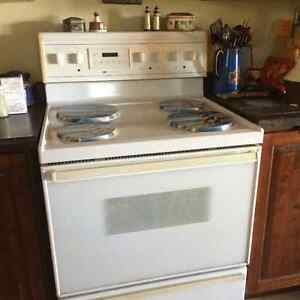 White Westonghouse 4 burner stove.  Oven & grill work well.