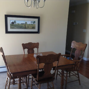 SOLID OAK TABLE AND 4 PRESS BACK CHAIRS FOR SALE