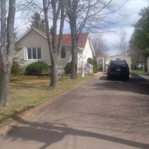 Corner Lot-Offers lots of curb appeal~Has 1 bedroom up & 2 down~