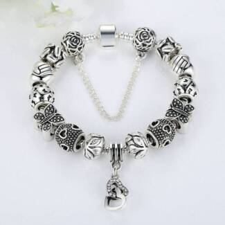 EUROPEAN SILVER PLATED CHARM BRACELET. 13 CHARMS & SAFETY CHAIN