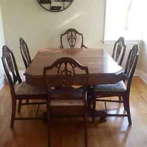 Solid wood dining table + 6 matching chairs