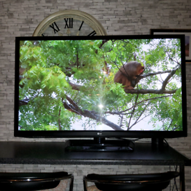 """. LG """"50 inch"""" T.V. with remote control & swivel base stand ."""