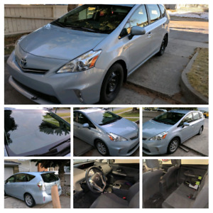 Immaculate 1 owner 2012 toyota prius v. Low km