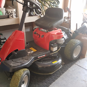 Small ride on lawn mower
