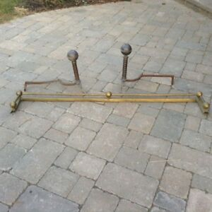 Antique fireplace rail and andirons
