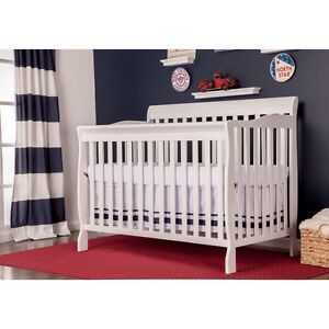 Beautiful baby crib - new in box 4 in 1 - overstock sale
